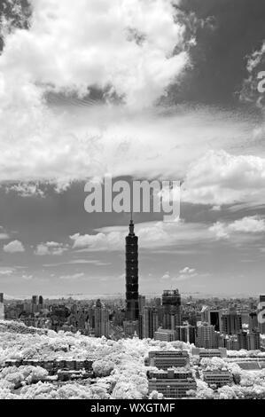 Taipei cityscape with famous landmark, 101 skyscraper under dramatic sky, infrared photography. Shoot at Taipei, Taiwan, Asia. - Stock Photo