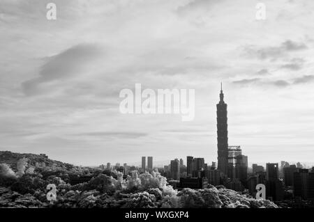 Cityscape with 101 skyscraper under dramatic clouds, infrared photography in Taipei, Taiwan, Asia. - Stock Photo