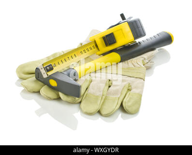 tapeline and hammer on gloves - Stock Photo
