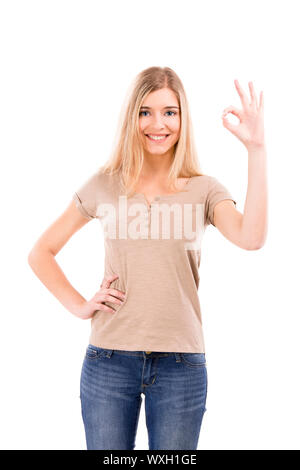 Beautiful blonde woman doing a Okay sign with her hand, isolated over white background - Stock Photo