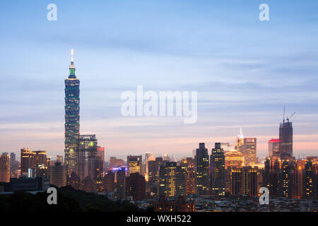 Taipei city night with famous landmark, 101 skyscraper, under blue and dramatic colorful sky in Taiwan, Asia. - Stock Photo