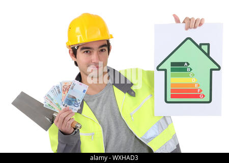 Tradesman holding up money - Stock Photo