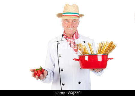 Italian cook with pan pasta and tomatoes - Stock Photo