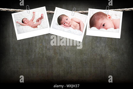 Three funny cute Caucasian Hispanic baby photos with white frame hanging on rope with paperclips on a gray grunge background. - Stock Photo