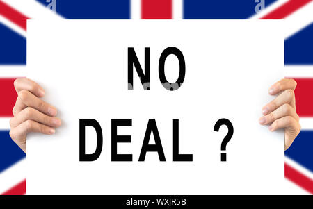 Hands holding a board 'No Deal', UK flag background, brexit concept - Stock Photo