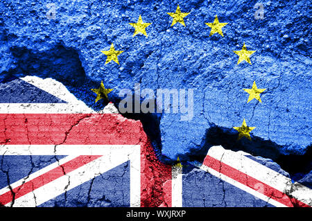 Brexit, Flags of the United Kingdom and the European Union on cracked background - Stock Photo