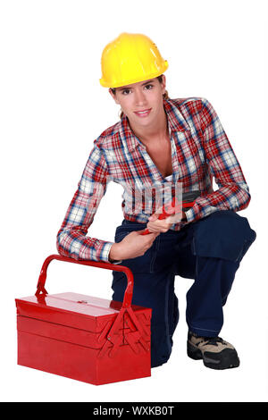 Tradeswoman holding a pipe wrench - Stock Photo