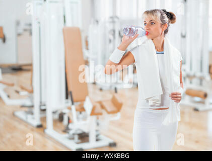 a sportswoman dring water from bottle - Stock Photo