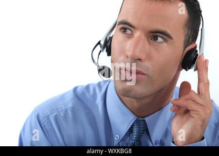 Man wearing a headset - Stock Photo