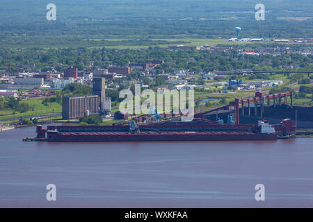 A Ship Being Loaded With Coal At Port - Stock Photo