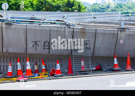 Pro-democracy graffiti on Garden Road, one of the major roads in the Central Hong Kong region of Hong Kong Island in China. - Stock Photo