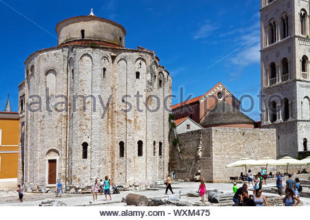 Zadar, Croatia - July 29th 2019: Church of St Donatus  on Roman Forum in Zadar, tourists are walking around. Photo taken on July 29th 2019. - Stock Photo