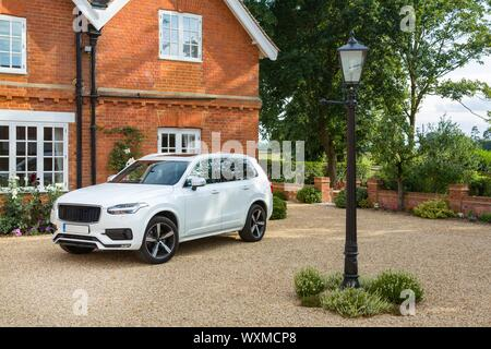 Executive house and luxury car in a rural setting, Buckinghamshire, England, UK - Stock Photo