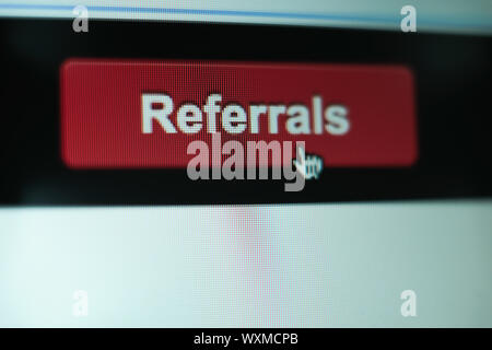 Close up Red button referals on a  white background. - Stock Photo