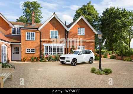 Large executive mansion house and luxury car in a rural setting, Buckinghamshire, England, UK - Stock Photo