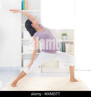 prenatal yoga class full length healthy asian pregnant