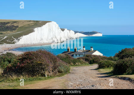 The Seven Sisters cliffs from Seaford Head above Cuckmere Haven, near Eastbourne, on the East Sussex coast, looking East, with coastguard cottages - Stock Photo