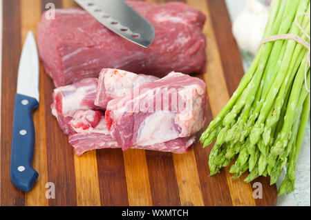 raw beef and pork ribs with asparagus and herbs ready to cook - Stock Photo