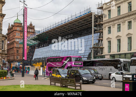 Glasgow Queen Street Railway Station under redevelopment with many of the new glass panels fitted to the frontage - Stock Photo