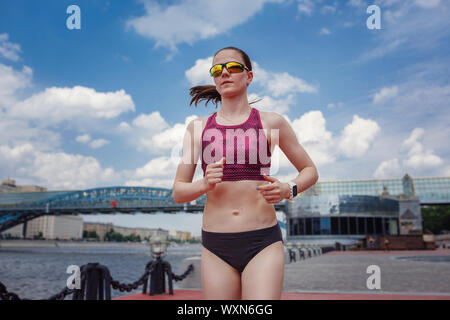 professional young female runner player running in park for training personal speed and explosive force at holiday weekend. The idea and concept of he - Stock Photo