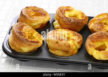 homemade freshly Yorkshire puddings, traditional British side dish - Stock Photo