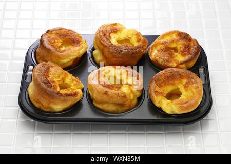 homemade freshly Yorkshire puddings, traditional British side dish - Stock Photo