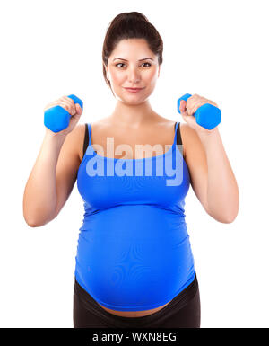 Sportive pregnant girl lifting dumbbells isolated on white background, workout indoors, sport for expectant female, healthy pregnancy concept - Stock Photo