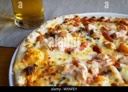 Pizza with seafood. Mozzarella, tuna and shrimps. - Stock Photo