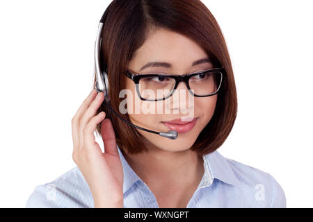 young smiling asian businesswoman call center agent isolated on white - Stock Photo