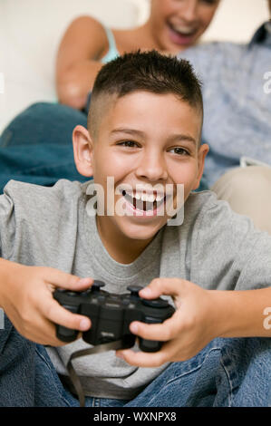 Boy Playing Video Games - Stock Photo