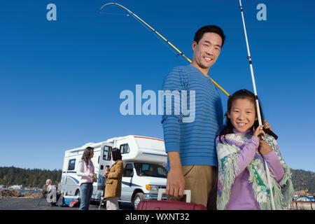 Man and Girl Going Fishing - Stock Photo
