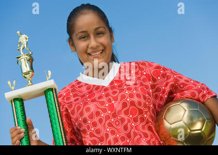 Teenage Girl with Soccer Trophy - Stock Photo
