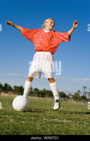 Teenage Girl Enjoying Playing Soccer - Stock Photo