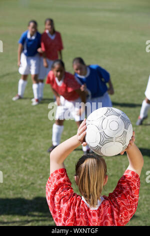 Female Players Playing Soccer - Stock Photo