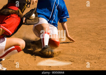 Close Call on Home Plate - Stock Photo