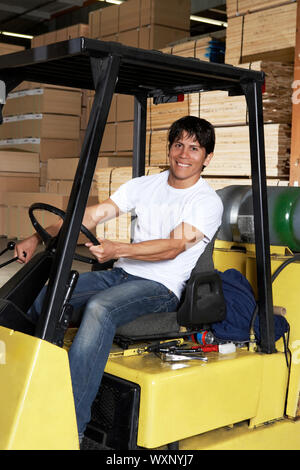 Driver on Forklift in Lumber Warehouse