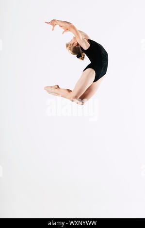 Young Gymnast Mid-air - Stock Photo