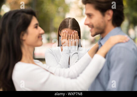 Woman crying, watching her ex boyfriend starts happy love relations - Stock Photo