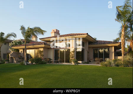 Backyard of House With Palm Trees - Stock Photo