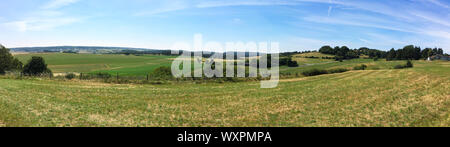 Wide Panorama of Eifel Landscape in Germany in the Summer with blue sky and sun shine - Stock Photo