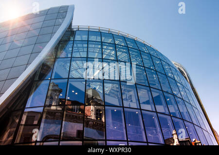 Katowice, Silesia, Poland; September 15, 2019: Decorative wall of Galeria Katowicka shopping mall with the reflection of old tenement houses - Stock Photo