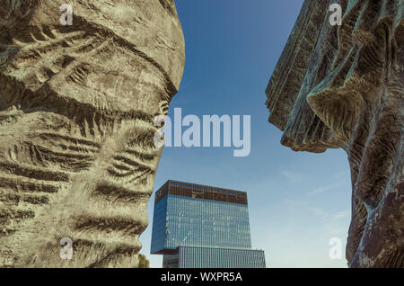 Katowice, Silesia, Poland; September 15, 2019:  Landmarks of Katowice: The Monument of Silesian Uprisings with the KTW business centre in the distance - Stock Photo