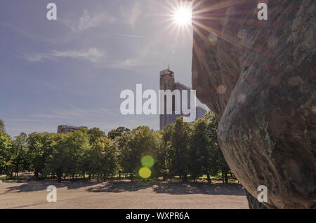 Katowice, Silesia, Poland; September 15, 2019: The Monument of Silesian Insurgents with the tower of Courtyard by Mariott hotel with lit by sunrays - Stock Photo