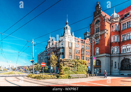 Katowice, Silesia, Poland; September 15, 2019: Townhouses at Korfanty Street in the center of Katowice with tram line and Spodek sports hall - Stock Photo