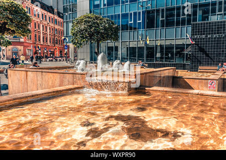 Katowice, Silesia, Poland; September 15, 2019:  Katowice main square with City Hall building and a decorative marble fountain - Stock Photo