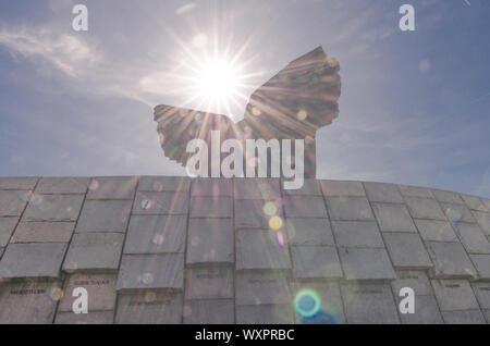 Katowice, Silesia, Poland; September 15, 2019:  The Monument of Silesian Uprisings lit by sun rays - Stock Photo