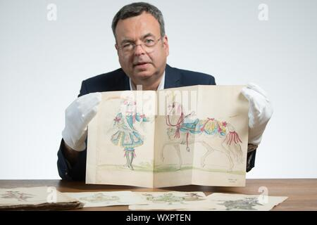 Dresden, Germany. 19th Aug, 2019. Peter Wiegand, Head of Department of the Saxon State Archives, holds a costume sketch from 1719. On 25 August 2019 Dresden celebrates the Prince's Wedding of Friedrich August II on the occasion of its 300th anniversary. Credit: Sebastian Kahnert/dpa-Zentralbild/dpa/Alamy Live News - Stock Photo