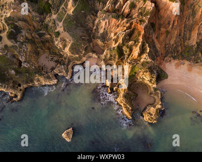 Algarve aerial drone panoramic view. Amazing landscape at sunrise. Beautiful beach near Lagos, Algarve region, Portugal.  Seascape with cliff rocks. - Stock Photo