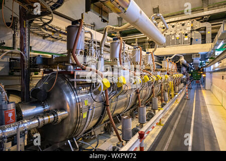 Superconducting radio-frequency cavity in the LHC tunnel, CERN - Stock Photo
