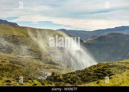 Spray from the Allt Mheididh waterfall being blown upwards by the wind, Talisker Bay, Minginish, Isle of Skye, Scotland, UK - Stock Photo